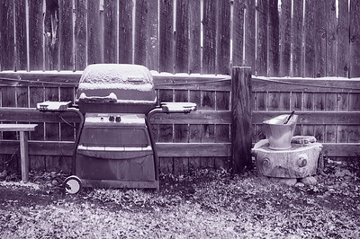 Old grill covered in snow.