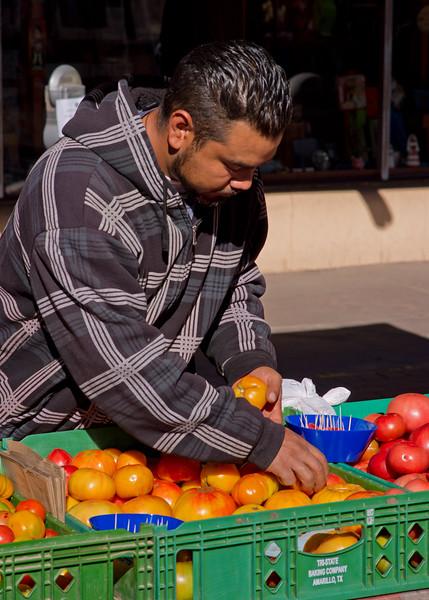 Tomato vendor; Taos farmer's market.