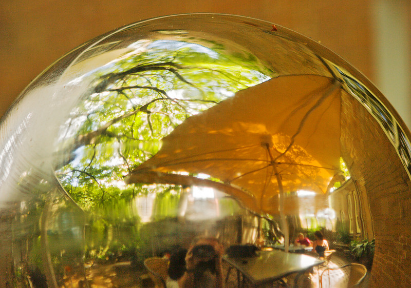 Our first accommodation was at Sydney Harbor Bed & Breakfast, near Circular Quay.  Breakfast was in a back courtyard, shown here partially reflected in a silver garden ball.