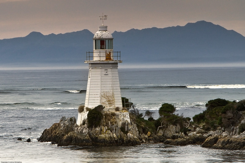 "A lighthouse at ""Hell's Gates""; the entrance to Macquarie Harbour on Tasmania's west coast."