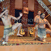 Maori  people performing traditional dances at the meeting house in Rotorua, New Zealand.