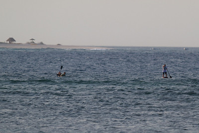 Paddling off Tavarua, with the beach of Namotu island in the background. Fiji