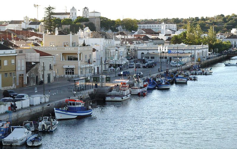 Downtown Tavira, Portugal; on the Gilhão River, separated from the sea by about a km of salt marsh.  The town was destroyed by an earthquake in 1755 and rebuilt in the eighteenth century.