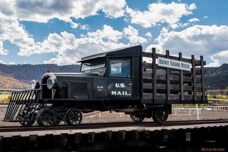 "The ""Galloping Goose"" mail car was designed and built in Ridgeway. It carried passengers in addition to mail and other packages using a narrow gauge rail."