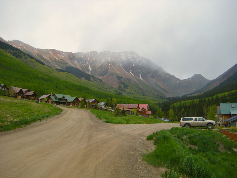 "Looking back on the metropolis of Ophir, Colorado.  The Ophir Pass road can be seen bisecting the ""lower"" mountain on the right."