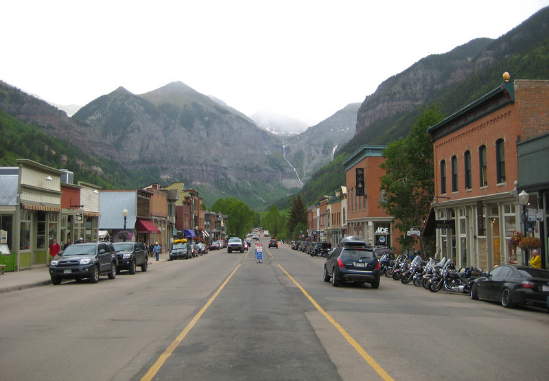 Telluride, Colorado.  I happened along during a Bluegrass Festival.  Tons of tents on the outskirts of town, and only vehicles registered in San Juan county were allowed in the city.  Just my luck the policeman at the roadblock entering town said motorcycles were OK to pass.
