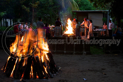 While the pre-Temascal ceremony takes place the preparation for the Temascal itself continues. Costa Azul, Sonsonate, El Salvador.