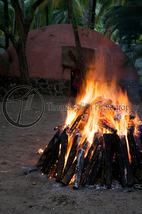 Here you can see the Temascal in the background. The first step is to make a pile of rocks and cover them with wood. You then wait until the wood is completely burned and the rocks are white hot and the ceremony begins.