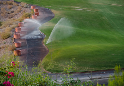 Watering golf course path 326