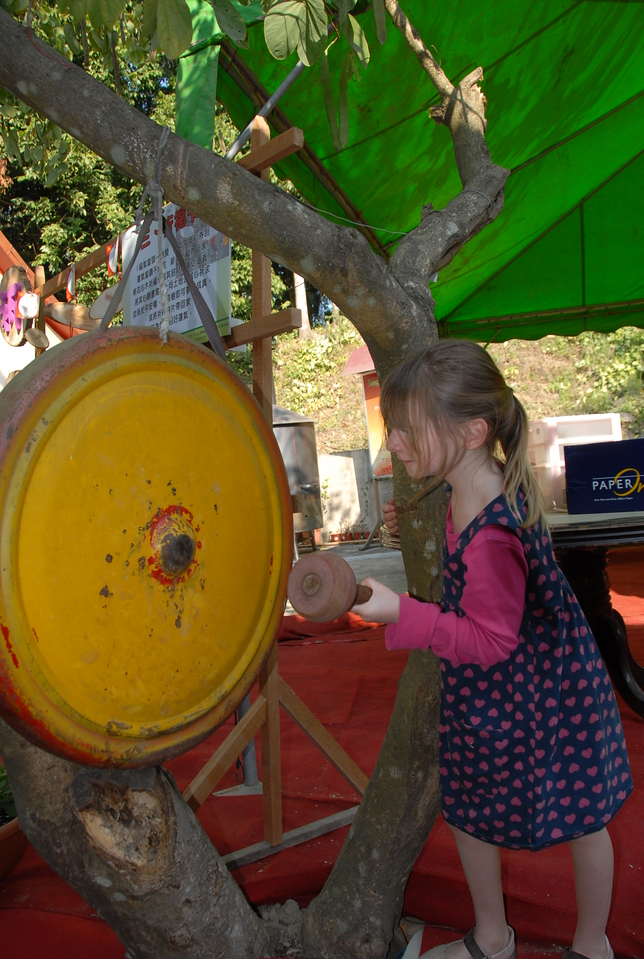 Sasha striking the gong