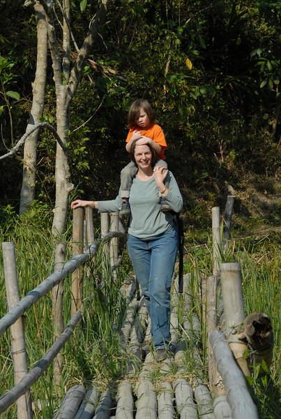 Ed crossing a bamboo bridge in style