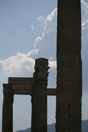 Temple of Olympian Zeus, Athens, Greece<br /> <br /> The Temple of Olympian Zeus is a colossal ruined temple in the centre of the Greek capital Athens that was dedicated to Zeus, king of the Olympian gods. Construction began in the 6th century BC during the rule of the Atheniantyrants, who envisaged building the greatest temple in the ancient world, but it was not completed until the reign of the Roman Emperor Hadrian in the 2nd century AD some 638 years after the project had begun. During the Roman periods it was renowned as the largest temple in Greece and housed one of the largest cult statues in the ancient world.<br /> <br /> The temple's glory was short-lived, as it fell into disuse after being pillaged in a barbarian invasion in the 3rd century AD. It was probably never repaired and was reduced to ruins thereafter. In the centuries after the fall of the Roman Empire, the temple was extensively quarried for building materials to supply building projects elsewhere in the city. Despite this, substantial remains remain visible today and it continues to be a major tourist attraction.