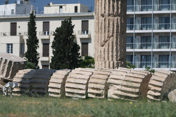 Temple of Olympian Zeus, Athens, Greece<br /> Remains of the temple, with a column that collapsed in 1852 in the foreground<br /> <br /> The Temple of Olympian Zeus is a colossal ruined temple in the centre of the Greek capital Athens that was dedicated to Zeus, king of the Olympian gods. Construction began in the 6th century BC during the rule of the Atheniantyrants, who envisaged building the greatest temple in the ancient world, but it was not completed until the reign of the Roman Emperor Hadrian in the 2nd century AD some 638 years after the project had begun. During the Roman periods it was renowned as the largest temple in Greece and housed one of the largest cult statues in the ancient world.<br /> <br /> The temple's glory was short-lived, as it fell into disuse after being pillaged in a barbarian invasion in the 3rd century AD. It was probably never repaired and was reduced to ruins thereafter. In the centuries after the fall of the Roman Empire, the temple was extensively quarried for building materials to supply building projects elsewhere in the city. Despite this, substantial remains remain visible today and it continues to be a major tourist attraction.