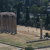 Temple of Olympian Zeus, Athens, Greece<br /> View from Acropolis<br /> <br /> The Temple of Olympian Zeus is a colossal ruined temple in the centre of the Greek capital Athens that was dedicated to Zeus, king of the Olympian gods. Construction began in the 6th century BC during the rule of the Atheniantyrants, who envisaged building the greatest temple in the ancient world, but it was not completed until the reign of the Roman Emperor Hadrian in the 2nd century AD some 638 years after the project had begun. During the Roman periods it was renowned as the largest temple in Greece and housed one of the largest cult statues in the ancient world.<br /> <br /> The temple's glory was short-lived, as it fell into disuse after being pillaged in a barbarian invasion in the 3rd century AD. It was probably never repaired and was reduced to ruins thereafter. In the centuries after the fall of the Roman Empire, the temple was extensively quarried for building materials to supply building projects elsewhere in the city. Despite this, substantial remains remain visible today and it continues to be a major tourist attraction.