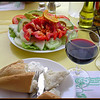 Salad, bread, ali oli and wine.  A great way to start a meal.
