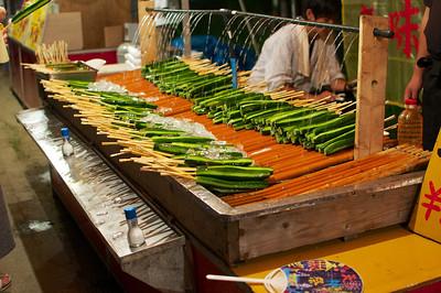 Osaka Tenjin Matsuri 2012. Cucumber on a stick! With salt! Delicous summer snack.