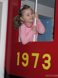 Riding on the indoor train, complete with LOUD train whistle.