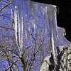 Icicles hang from the roof of the cave at its entrance.