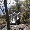 Bridge from the trail out onto an overlook at the Summit of Black Mountain.<br /> The bridge is made of recycled materials including recycled PET.