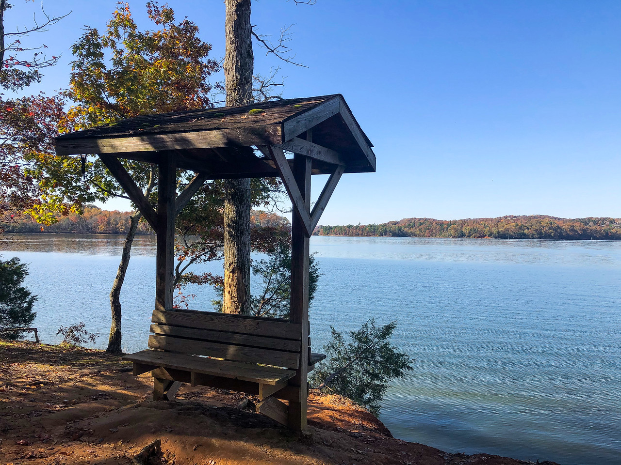 A bench on the shoreline of the lake.