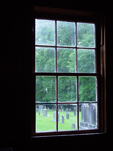 A window looking out into the forest.