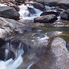 A mountain stream flowing around rocks in the Great Smoky Mountains National Park.