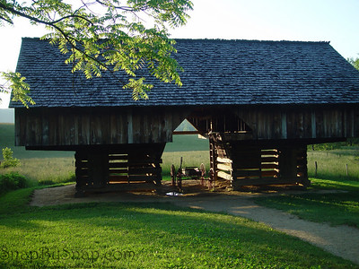 A carriage in a barn with evening light passing through it in the Great Smoky Mountains National Park.