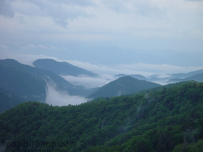 Misty morning clouds rise from the valleys in the Great Smoky Mountains National Park.