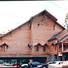Old Mill Craft Village - Pigeon Forge, TN  6-5-94<br /> Ben is standing at the car dwarfed by the huge structure.