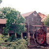 Old Mill Craft Village - Pigeon Forge, TN  6-5-94<br /> The Old Mill and The Old Mill Square is a complex of restaurants and specialty shops for dining, shopping and learning.  Visitors can still watch meal and flour being ground by the water powered granite French Burhr in the mill, or pottery being thrown or candy being made.