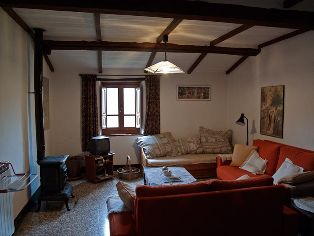 The loungeroom with pot bellied stove.