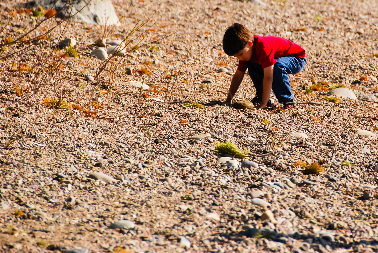 Keval entertaining himself with rocks
