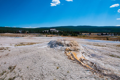 Yellowstone - geothermal feature with Old Faithful Inn in background
