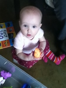 Vivian enjoying the selection of new toys loaned from friends and brought by family.
