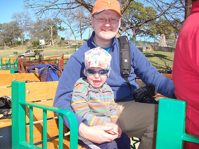 Theo and Daddy riding the train. It went over a bridge and through a tunnel between two playscapes, so it hit all the basic requirements for Theo's obsession with trains.