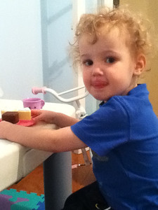 Theo preparing some tea and cake for everyone. He adored Samantha's kitchen and baking sets.