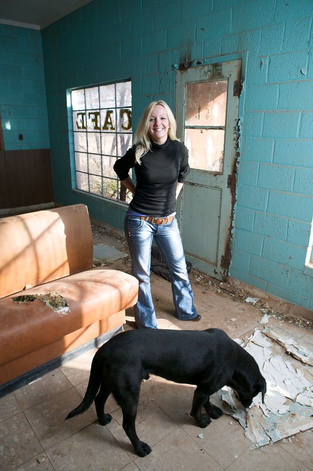 Glenrio, Texas. Byrony Steel and the dog owned by the last resident of Glenrio, Roxann Travis.