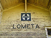 WELCOME TO LOMETA I remember how sad I was the first time I came through Lometa and noticed the old train depot was gone, replaced by a tin building, the symbol of our modern culture. Then I read about Lometa on the Texas Escapes Online Magazine and it said that the depot had been moved to the north end of town and was awaiting restoration. That was written in 2000. Well, this time through I finally located the old building and it is <i>still</i> awaiting restoration. I do wish they'd get on with it before the place falls apart.