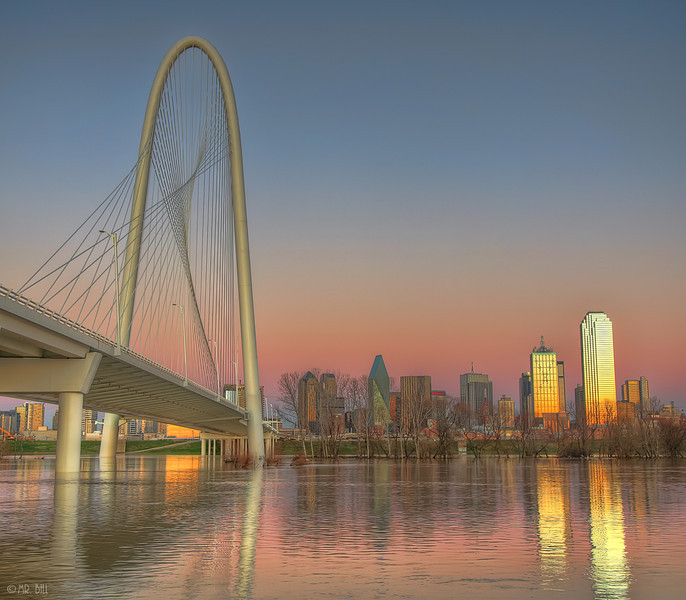 Margaret Hunt Hill bridge and Downtown Dallas, TX at sunset