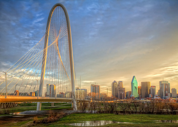 Margaret Hunt Hill bridge and Downtown Dallas, TX at sunrise