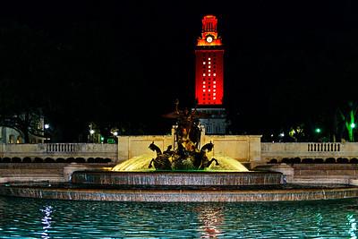 UT Tower lit in burnt orange in honor of the graduates