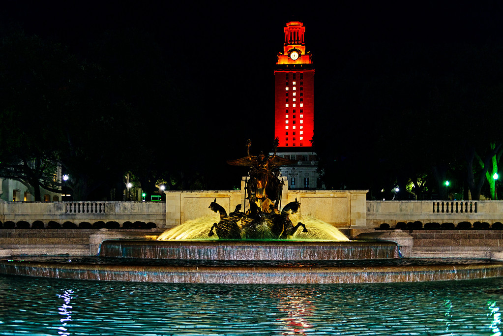 UT Tower lit in burnt orange in honor of the graduates