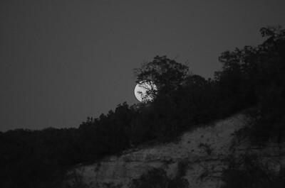 Full Moon coming up  over the hillside at La Lomita Ranch.