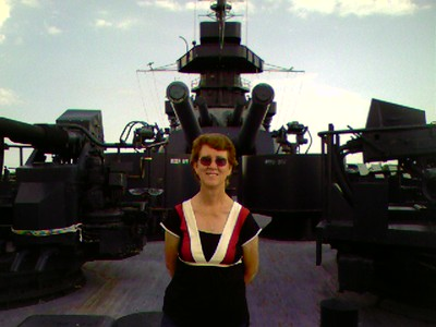 Jeanie on the stern of the Texas in front of the 14 inch gun turret # 5