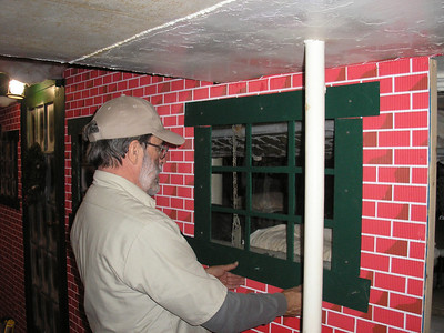 Re-creation of a Christmas Display in the Marine compartment of the ship, John is checking the trim.