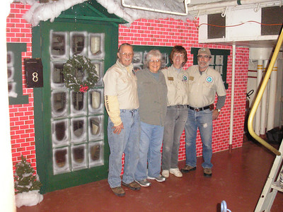 The original Christmas House Facade was a contest won by the Marines on the Battleship Texas held in 1933, the original was lost due to deterioration from age, we had comments from men who served on ship that we re-created a good likeness to the original.  Ken and Patti Marsh, Jeanie and John Hoyle