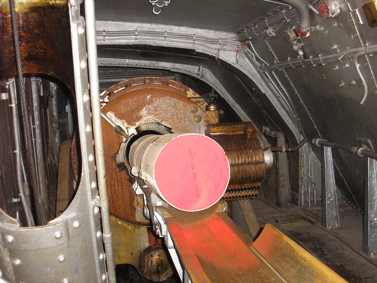 """3 one hundred and five lb. powder bags follow the shell into the 14"""" gun"""