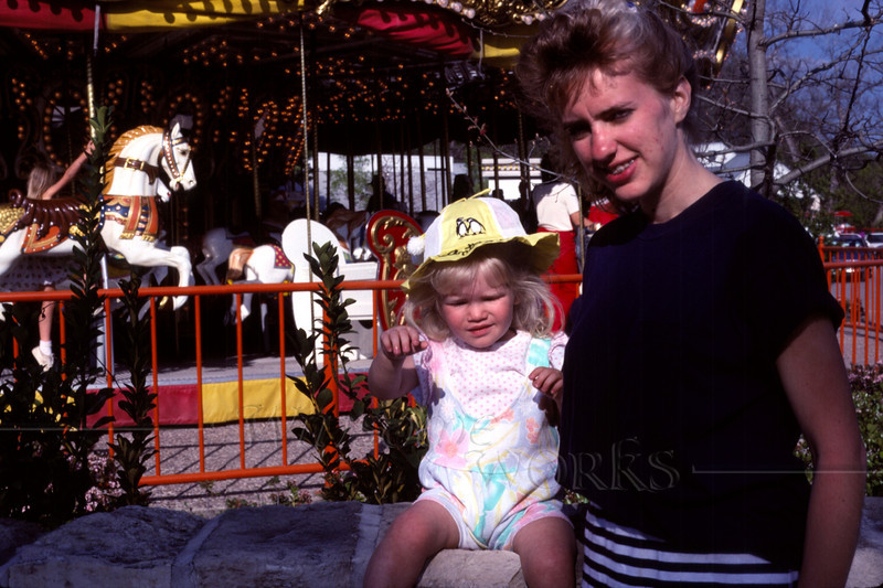 My sister Lydia with Trudy (age 1 1/2) at a carousel in San Antonio