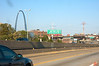 The famous arch of St Louis and a billboard for Jesus.<br /> IMG_0331