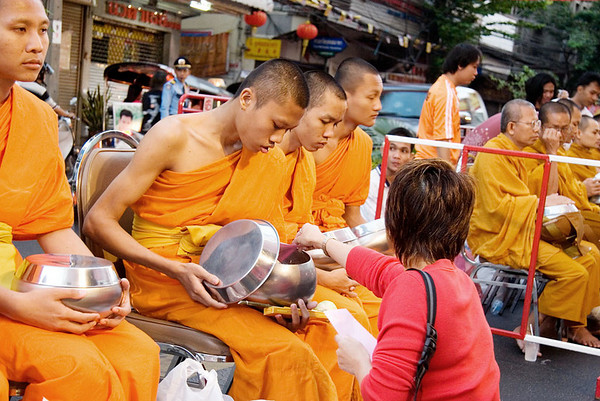Monks'daily alms round<br /> <br /> This photo was taken on the street just ouside the Grand China Princess Hotel shortly after dawn.